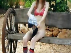 Ultra skinny teen fingering on a bench