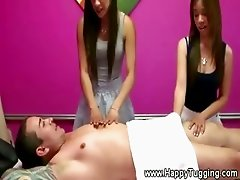 Two asian masseuses for this lucky client during his massage