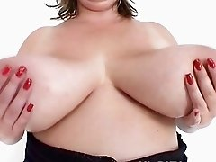 Fat white MILF hoe shows off her mega sized breasts