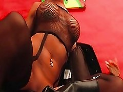Heavy chested blonde in black boots masturates with big dildo