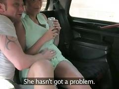 Couple horny in the backseat of a taxi