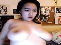Big breasted Asian camgirl makes herself cum with sex toys