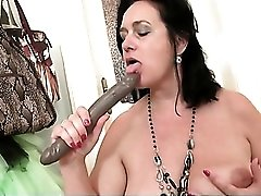 Milf sucks a toy to make it wet for her hot cunt