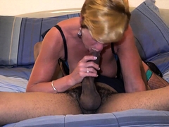 Busty blonde cougar in lingerie gives a big black cock a try