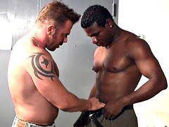 muscular white guy making love with a black man