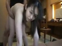 Sexy Asian chick moans while letting in this dude's vicious