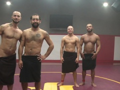 Muscular jocks wrestling naked in threesome