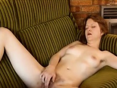 Horny Red Haired Woman Rubbing Her Twat