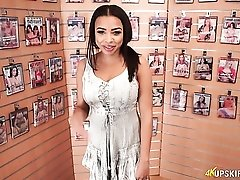 Beauty at the porn store lets you jerk off to her