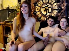 Lucky boy has two lovely babes stroking his cock on webcam