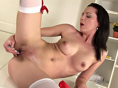 brunette in white stockings is naughty her fingers with pussy