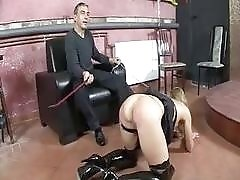 Maledom master and his slave have a whipping session BDSM