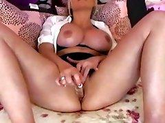 Pretty Babe Fucks Herself With A Glass Dildo
