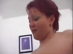 Chunky redhead loves it on her tits