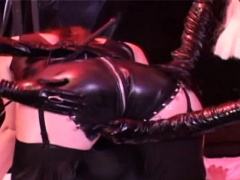 Maike is a hot lesbian who loves latex. Her and her 2 girlfr
