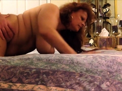 Big breasted mature redhead loves to get nailed doggystyle