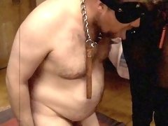 Slave learns how to suck Mistress May's strapon
