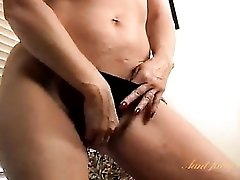 Mom pleasures with big clit with a vibrator