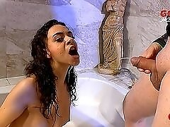 Pissing in the mouth of a pretty girl in the bathtub