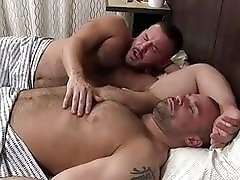Handsome bear masturbates while his lover licks his feet