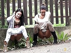 Friends drop their pants and piss outdoors
