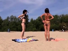 Two sexy slender babes get naked and enjoy the hot sun