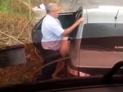 Fat old man gets caught on cam while drilling a ho outdoors
