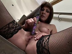 busty mom plays with herself on a flight of stairs