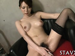 Ravishing asian with nylons gives blowjob in threesome