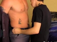 Inked twink blows his beefy boss