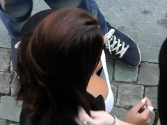 Street voyeur films a gorgeous babe with a fabulous cleavage