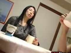 Japanese MILF Masturbating At The Table