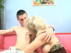 Grandma fucks a young stud with a strap-on