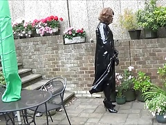 Alison in PVC and Thigh Boots spraying spunk over the garden