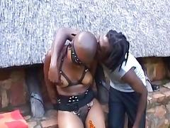 Bald submissive African bondage slave getting her pussy fucked outdoors