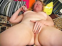 Pink lace is pretty on her amateur mature body