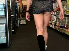 Naughty mature lady flashes her honey hole in a public place