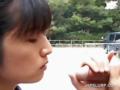 Asian cutie sucking schlong outdoor