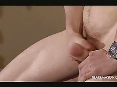 Gay stud squeezes his cock
