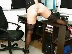 Foxy brunette fist fucking her asshole
