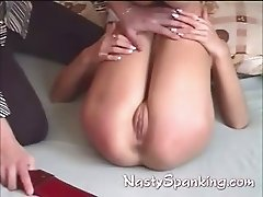 spanked while sucking cock